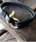 black leather bracelet with brass shackle